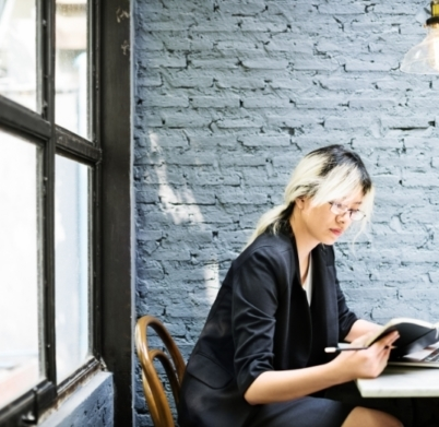 asian-businesswoman-laptop-planning-strategy-PQFT2HE@2x-402x391
